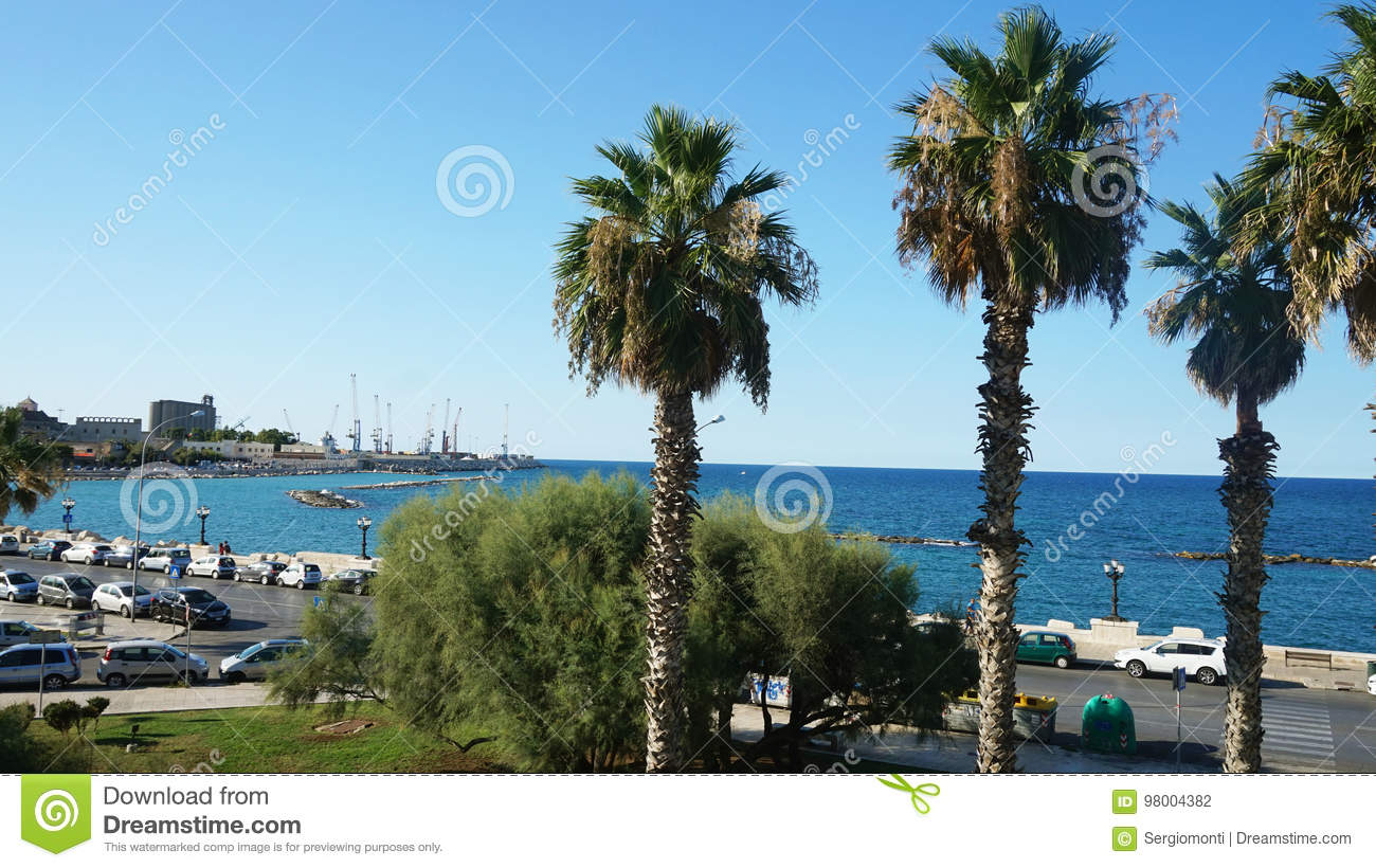 BARI, ITALY - JULY 28, 2017: view of Bari harbor with palm trees in the evening, Apulia, Italy