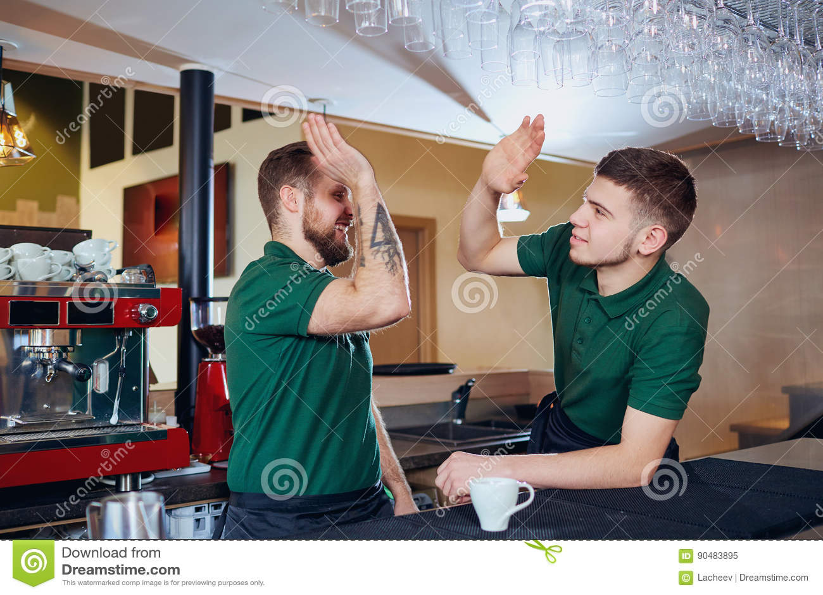 The barista barman team is a waiter at the bar restaurant cafe.