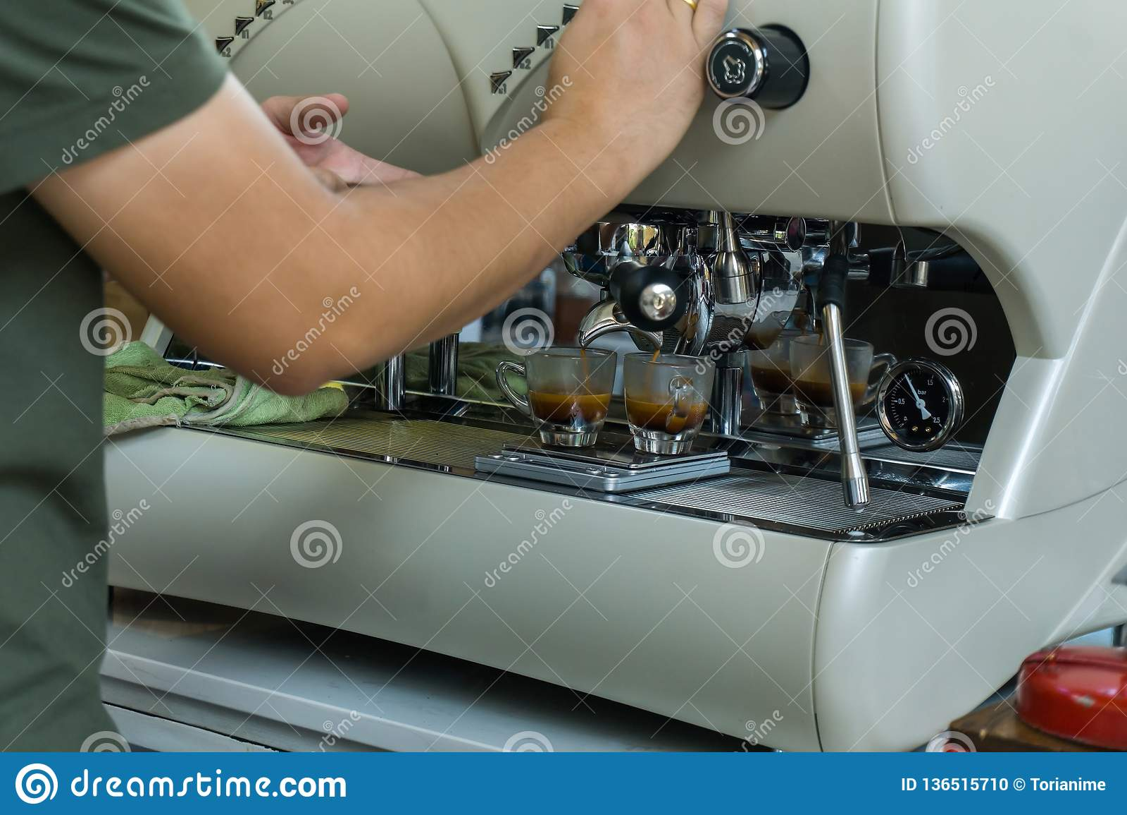 Barista making espresso coffee by espresso machine preparation service customer