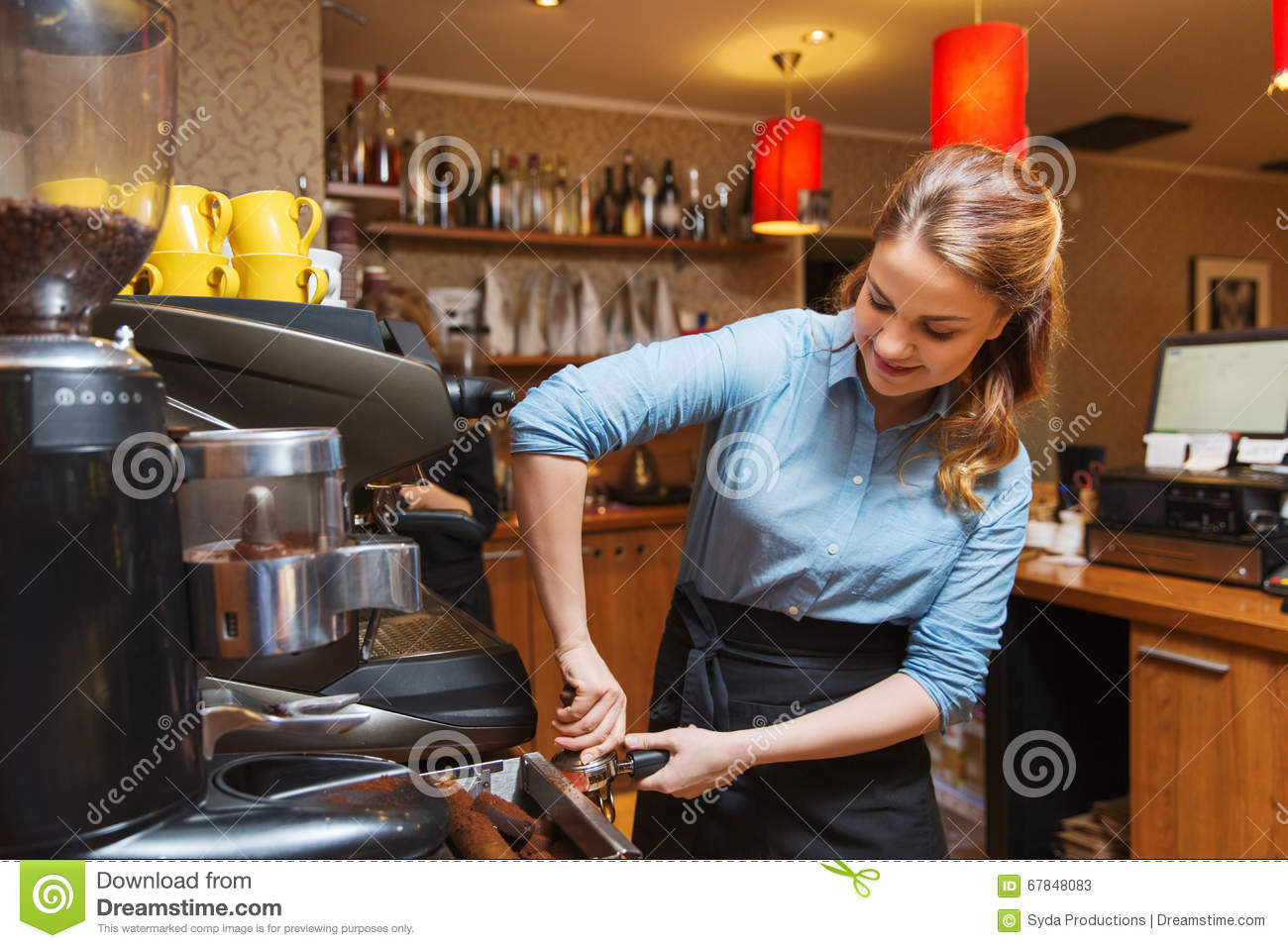 Barista Woman Making Coffee By Machine At Cafe Stock Photo