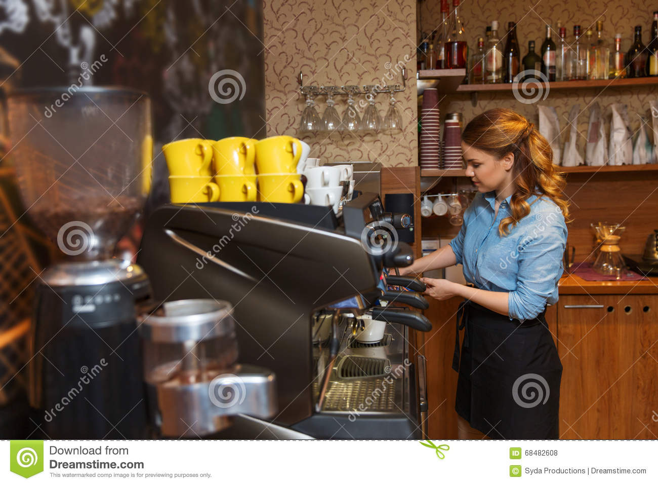 Barista woman making coffee by machine at cafe stock photo for Equipement cafe