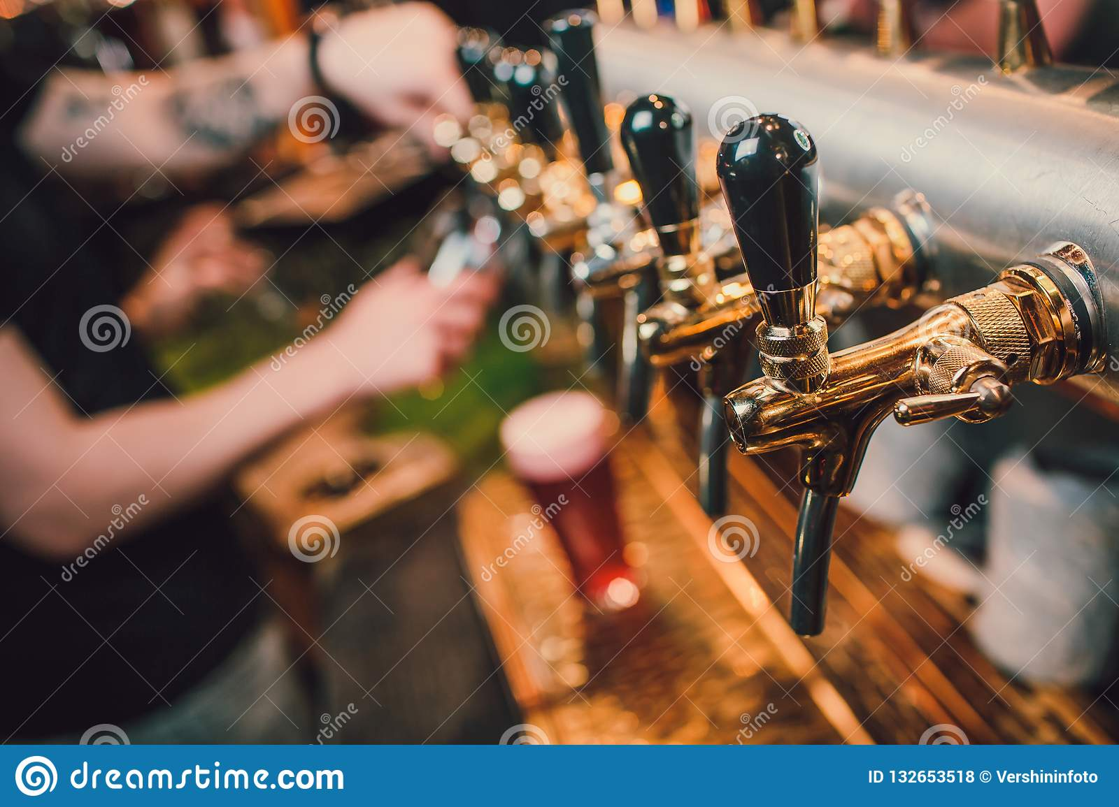 Barman Hands Pouring A Lager Beer In A Glass. Stock Photo ...