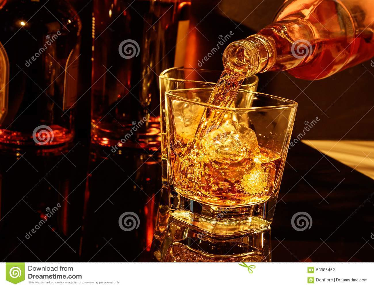 Pouring Whiskey Into Glass Stock Photography ...