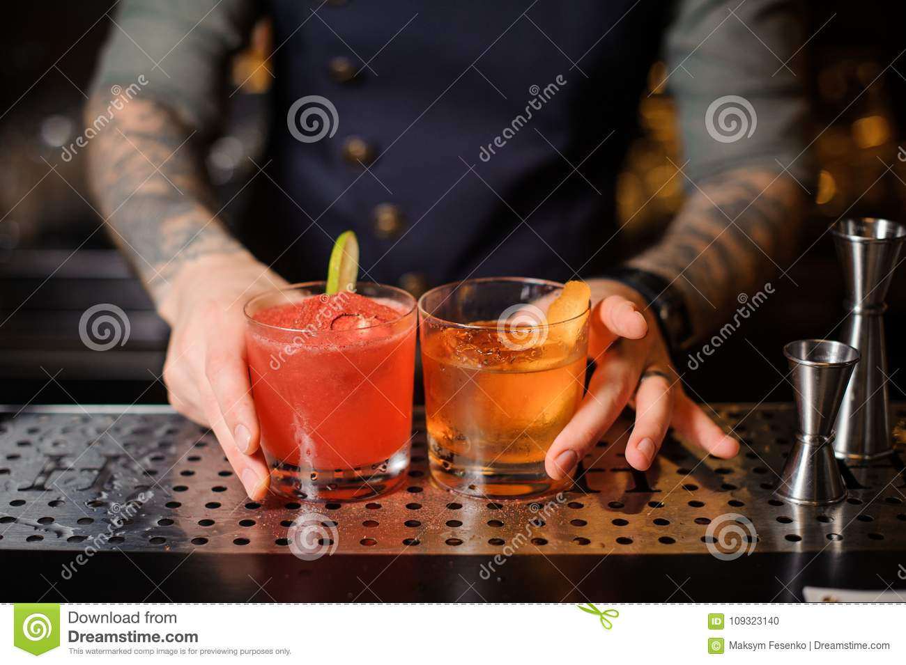Barman Prepared Two For The Bar Two Prepared Cocktails Of rojo And Orange Stock 2182b3
