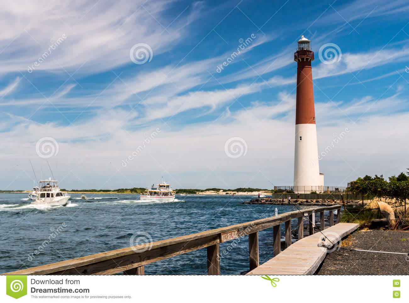 Barnegat inlet and lighthouse in long beach island stock for Long beach fishing boat