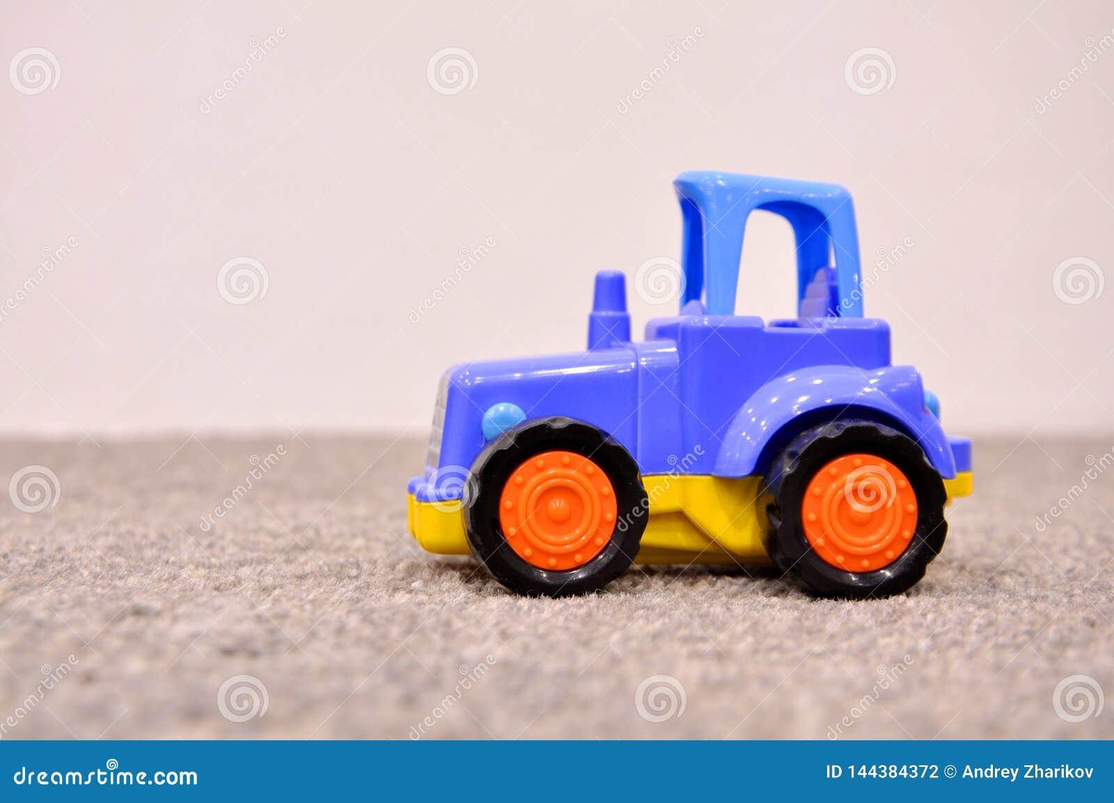 Barns leksak, blå traktor