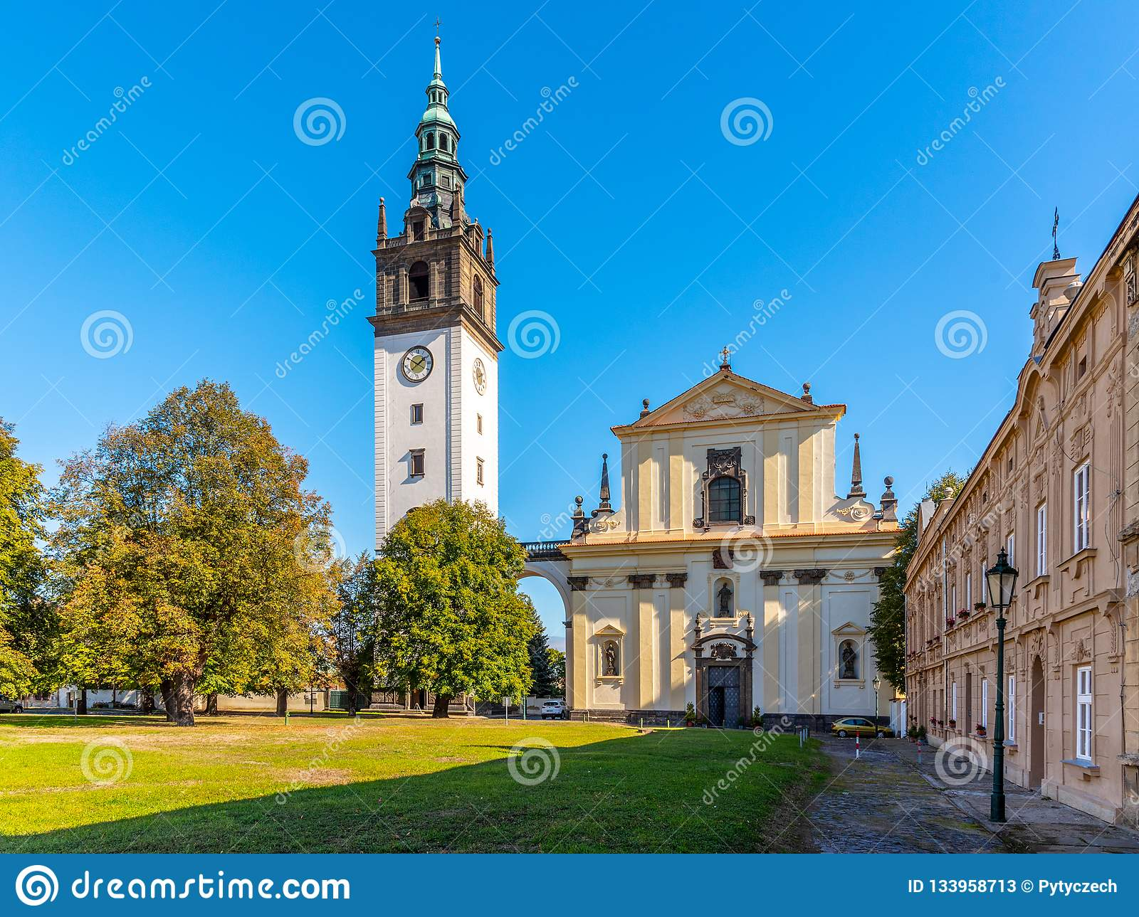 Baroque St. Stephen`s Cathedral with bell tower at the Cathedral Square in Litomerice, Czech Republic