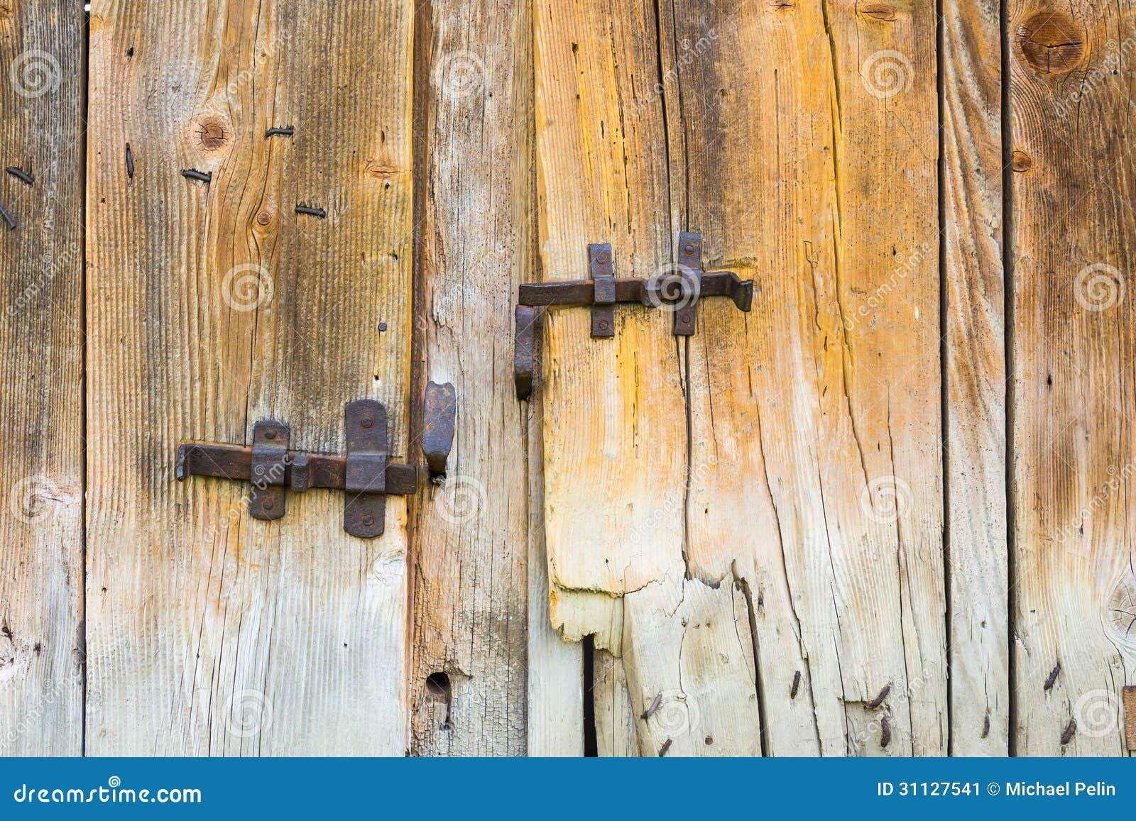 Barras labradas del vintage en puertas de granero de for Puerta granero madera