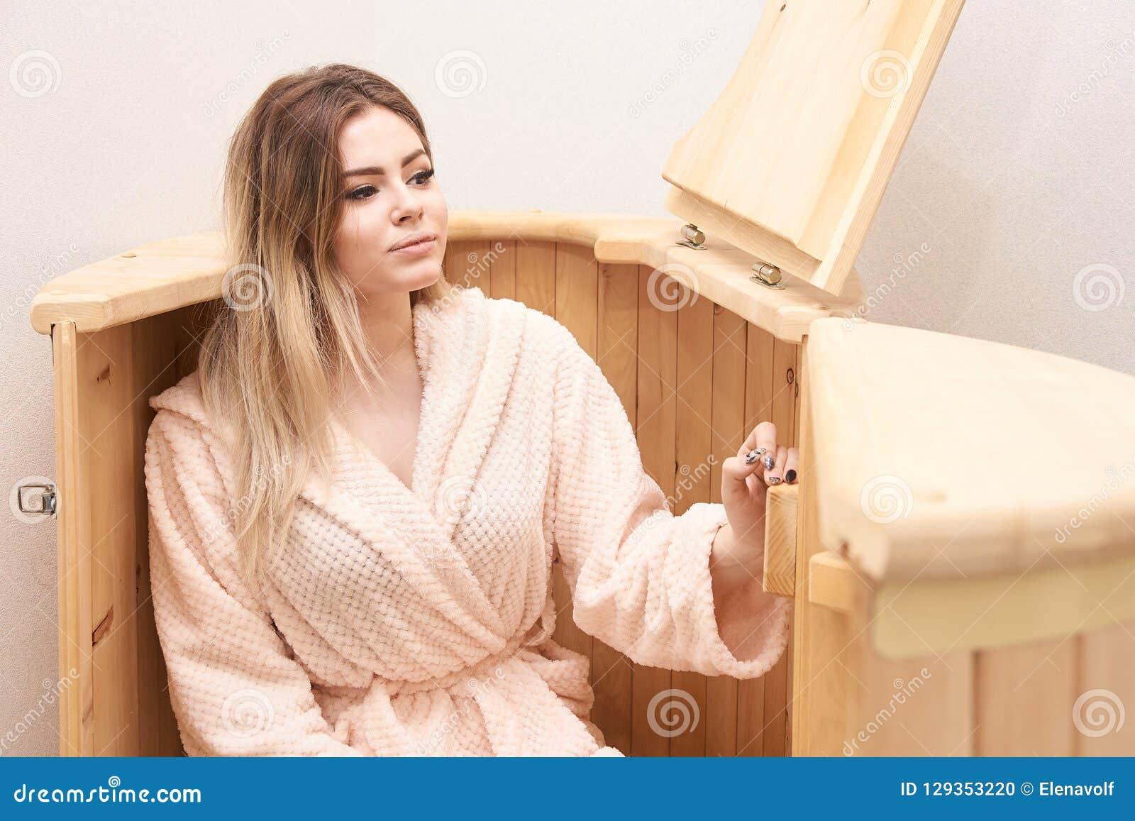 Barrel cedar. Wellness spa sauna. Aromatherapy treatment. Young beauty woman. Girl face