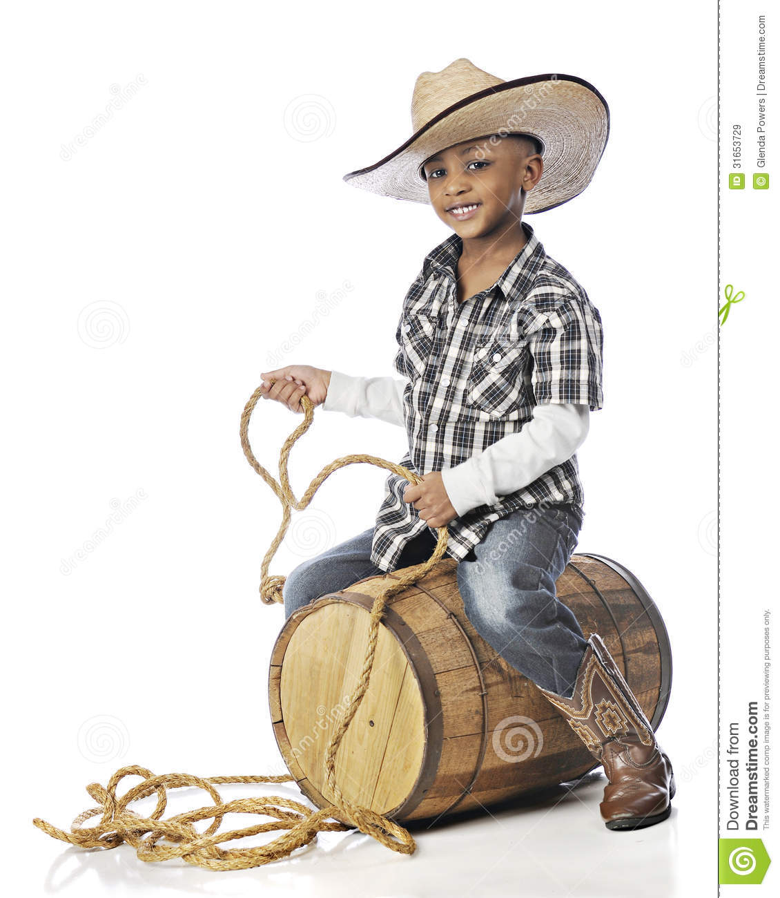 handsome elementary cowboy happily holding a rope while riding an ...: dreamstime.com/royalty-free-stock-images-barrel-rider-handsome...