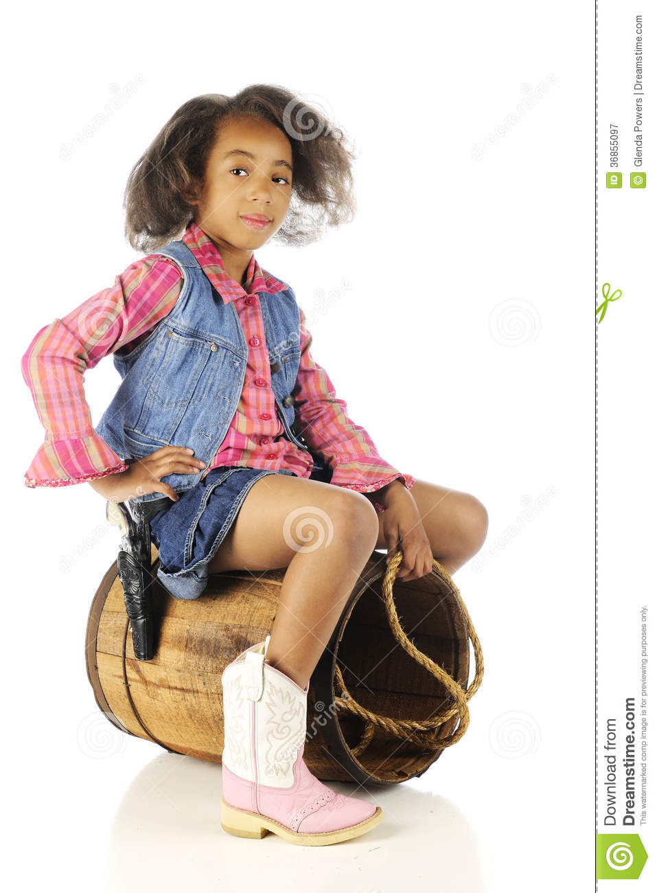 young elementary cowgirl riding on an old barrel. On a white ...: dreamstime.com/royalty-free-stock-photography-barrel-rider-young...