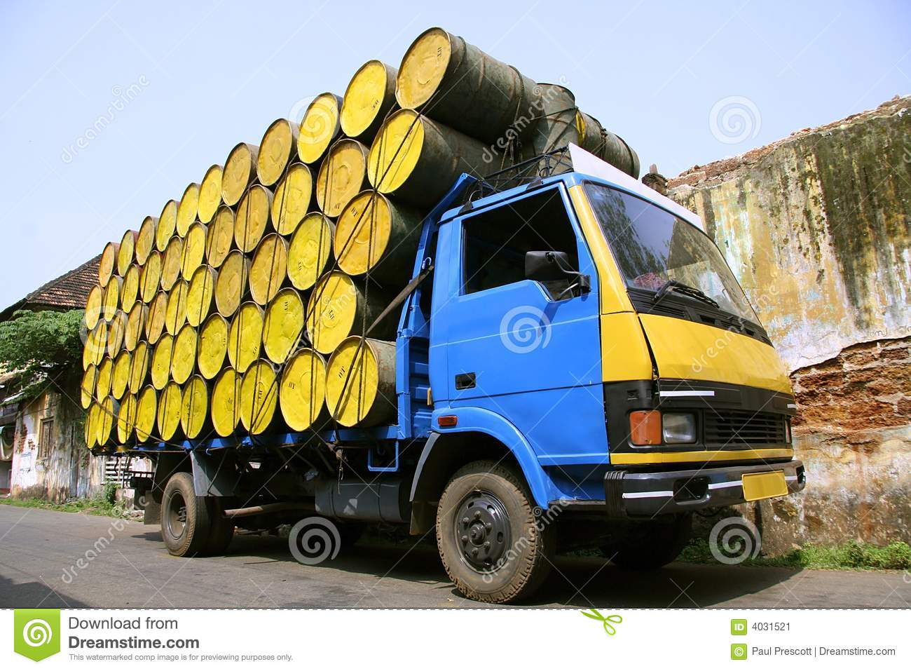 Barrels stacked atop truck