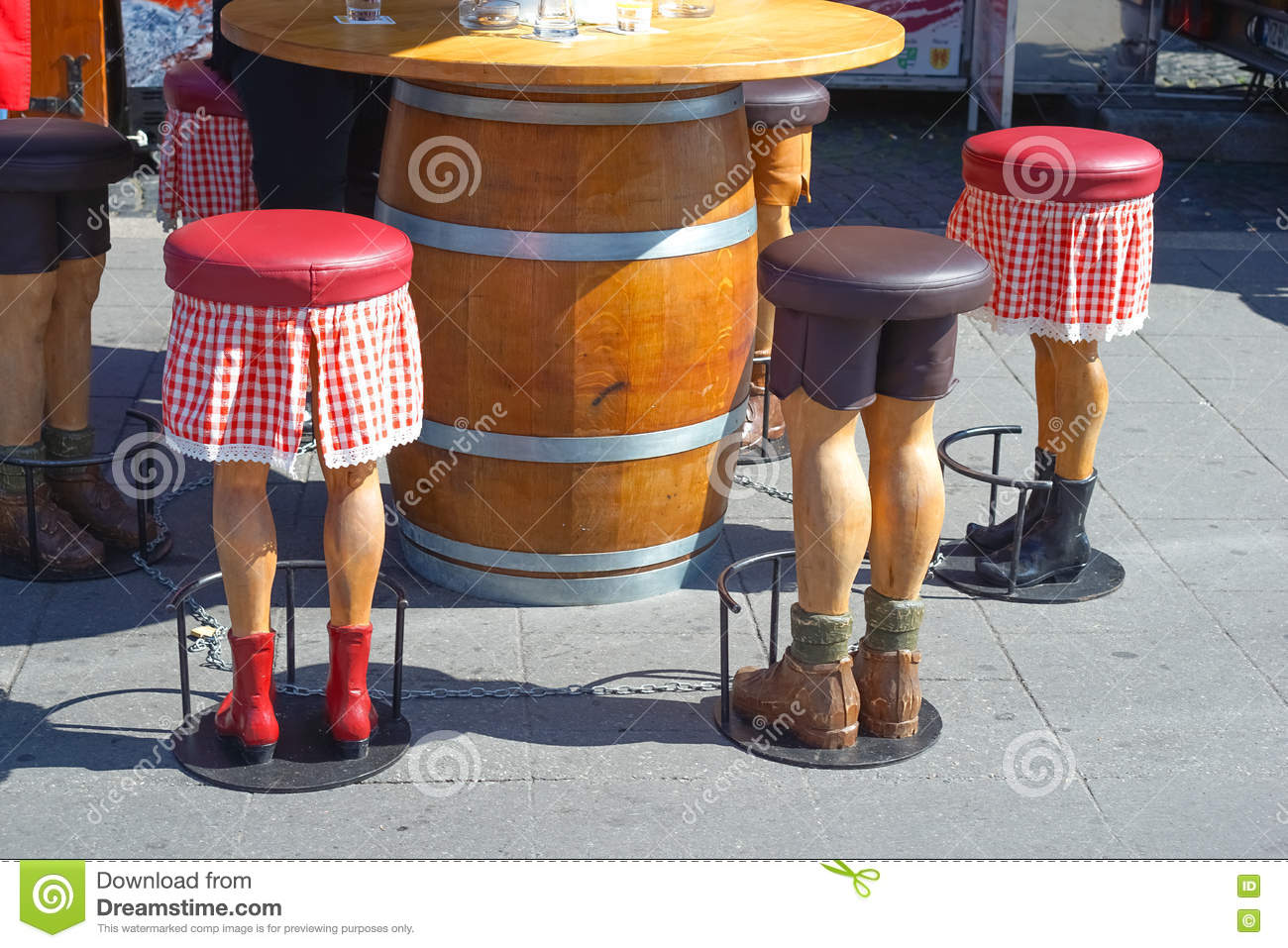 Barstool In The Form Of Human Legs Funny Stock Photo