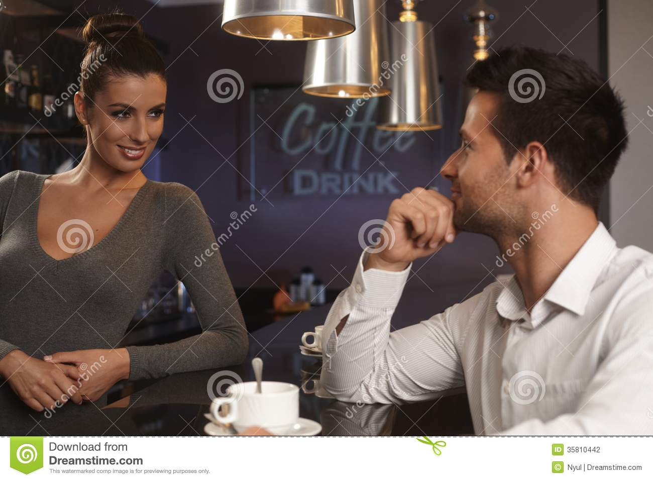 Female bartender standing in a bar and smiling hot girls wallpaper