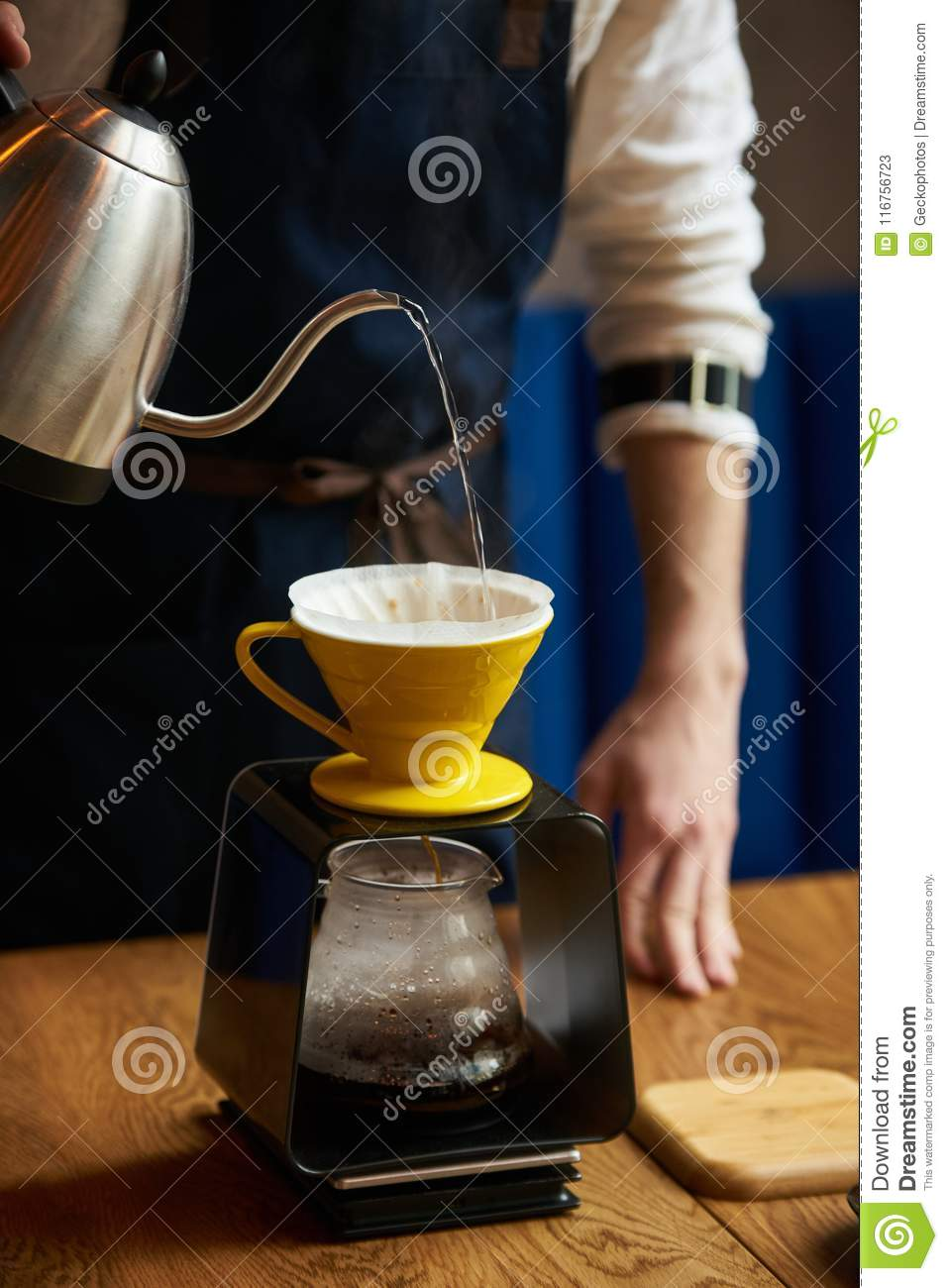 Barista Pouring Water On Coffee Ground With Paper Filter ...