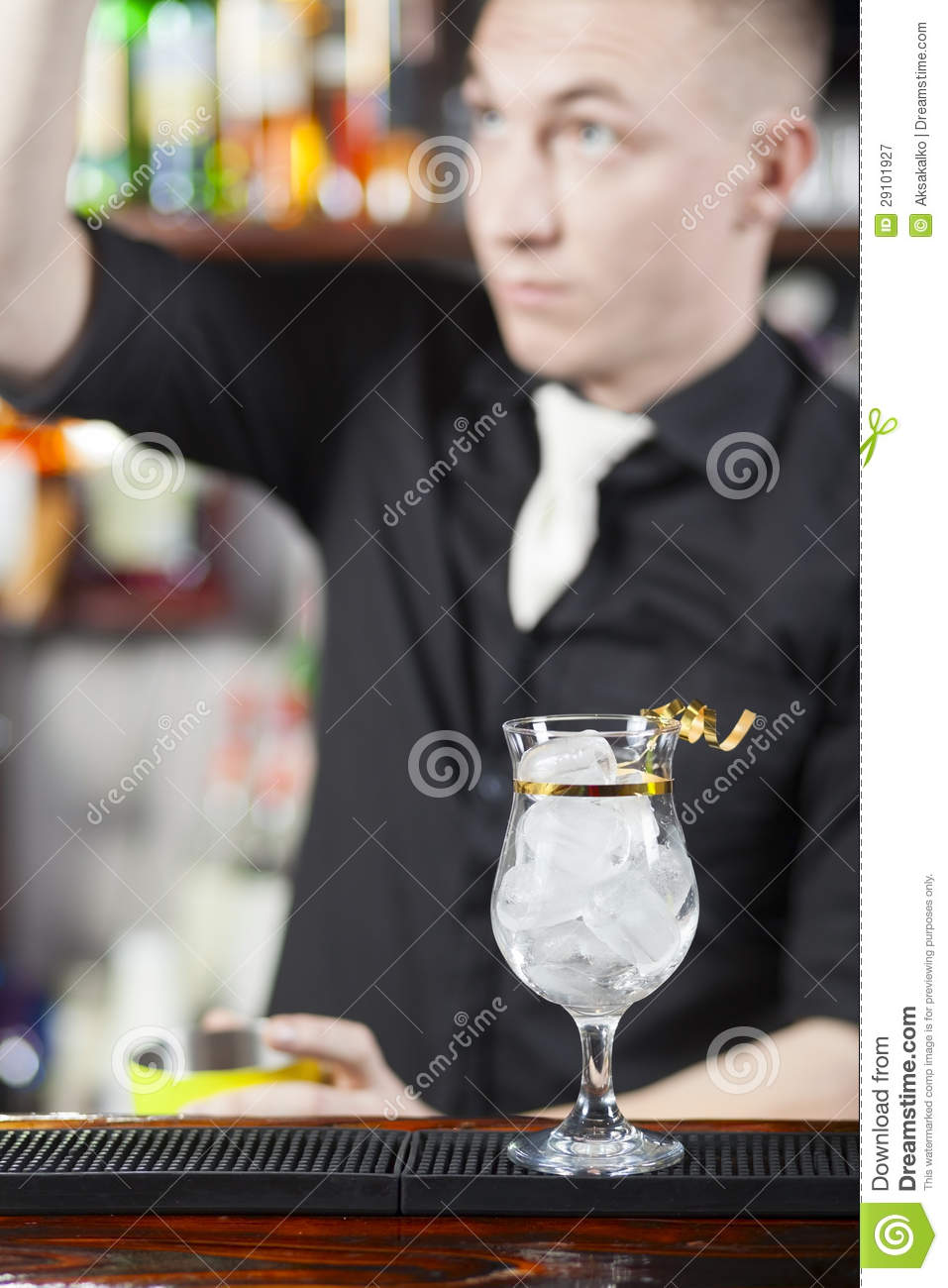 Bartender is making cocktail royalty free stock for Cocktail bartender