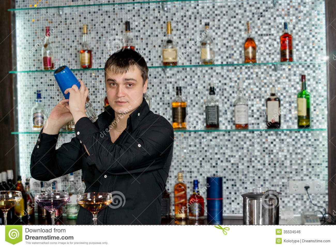 Bartender Mixing Liquors With The Cocktail Shaker Royalty Free ...