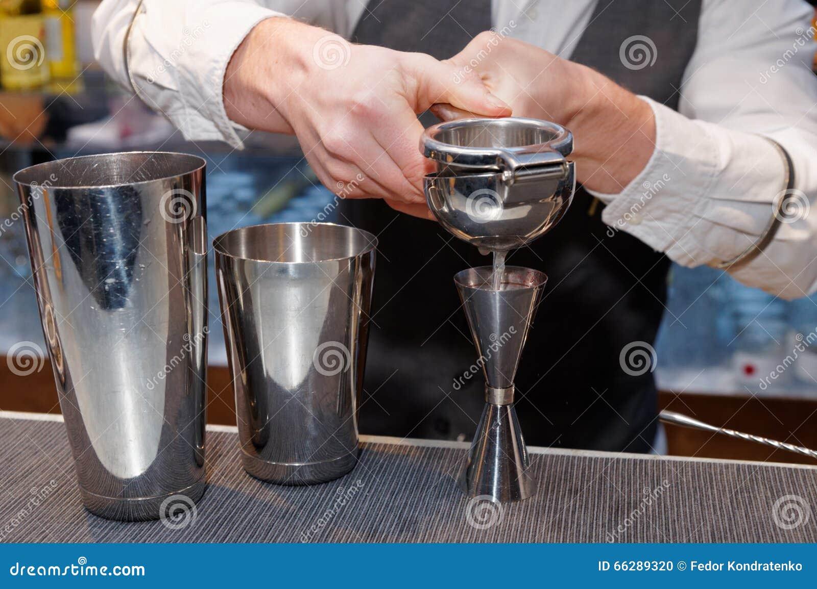 Bartender is squeezing citrus juice