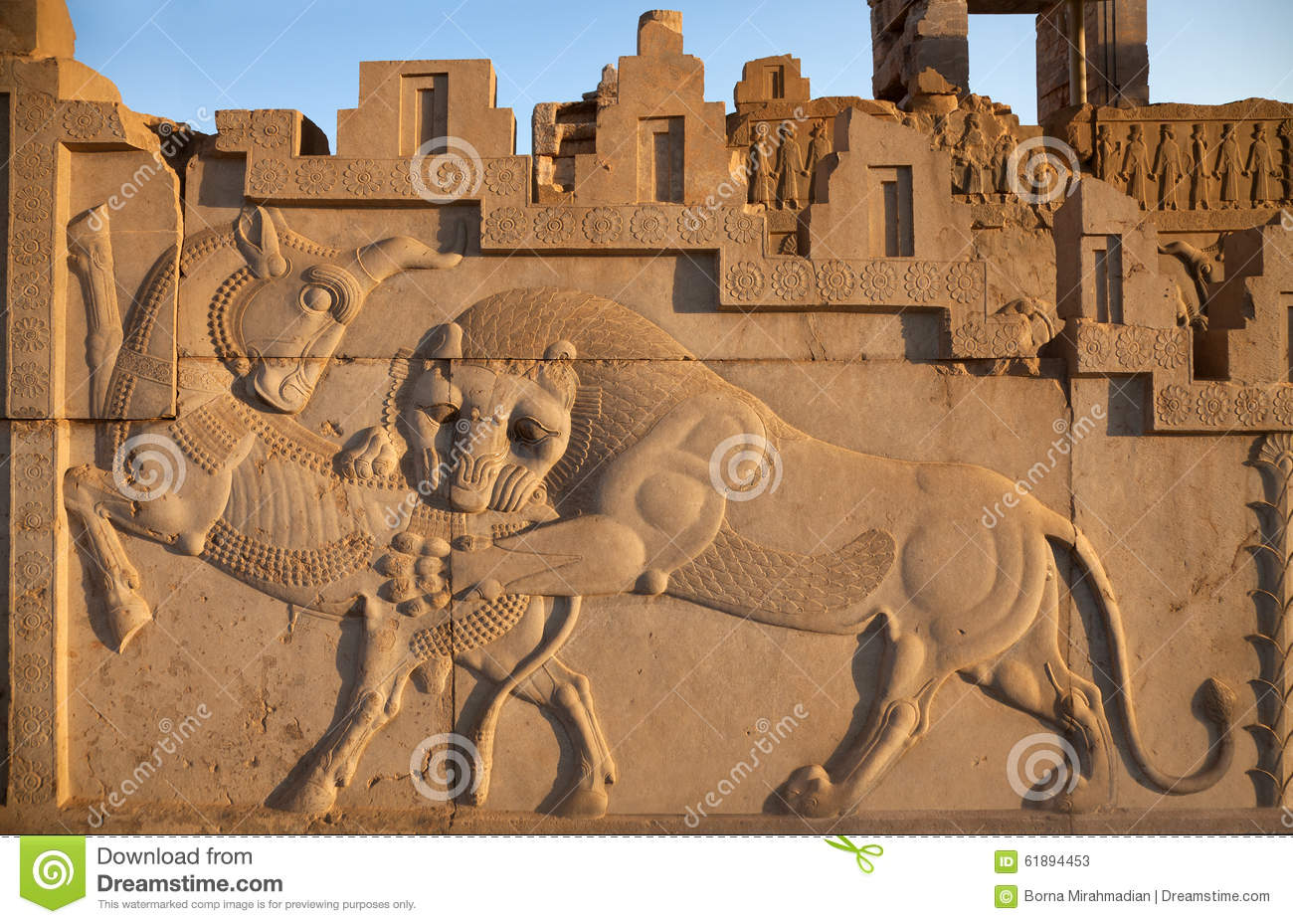 Bas relief carving of a lion hunting bull in persepolis