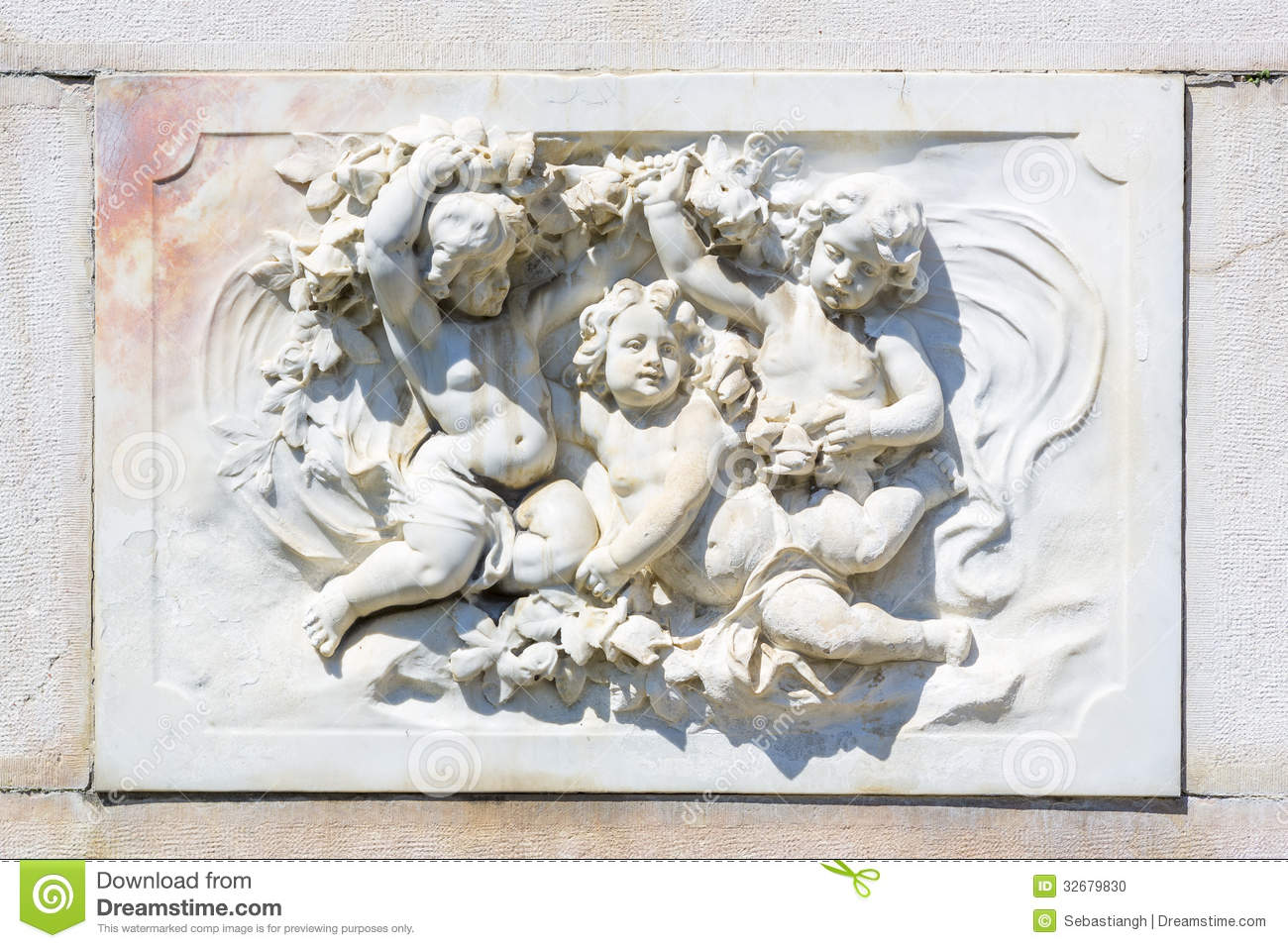 Bas Relief Marble Sculpture With Babies On Peles Castle Wall In Sinaia