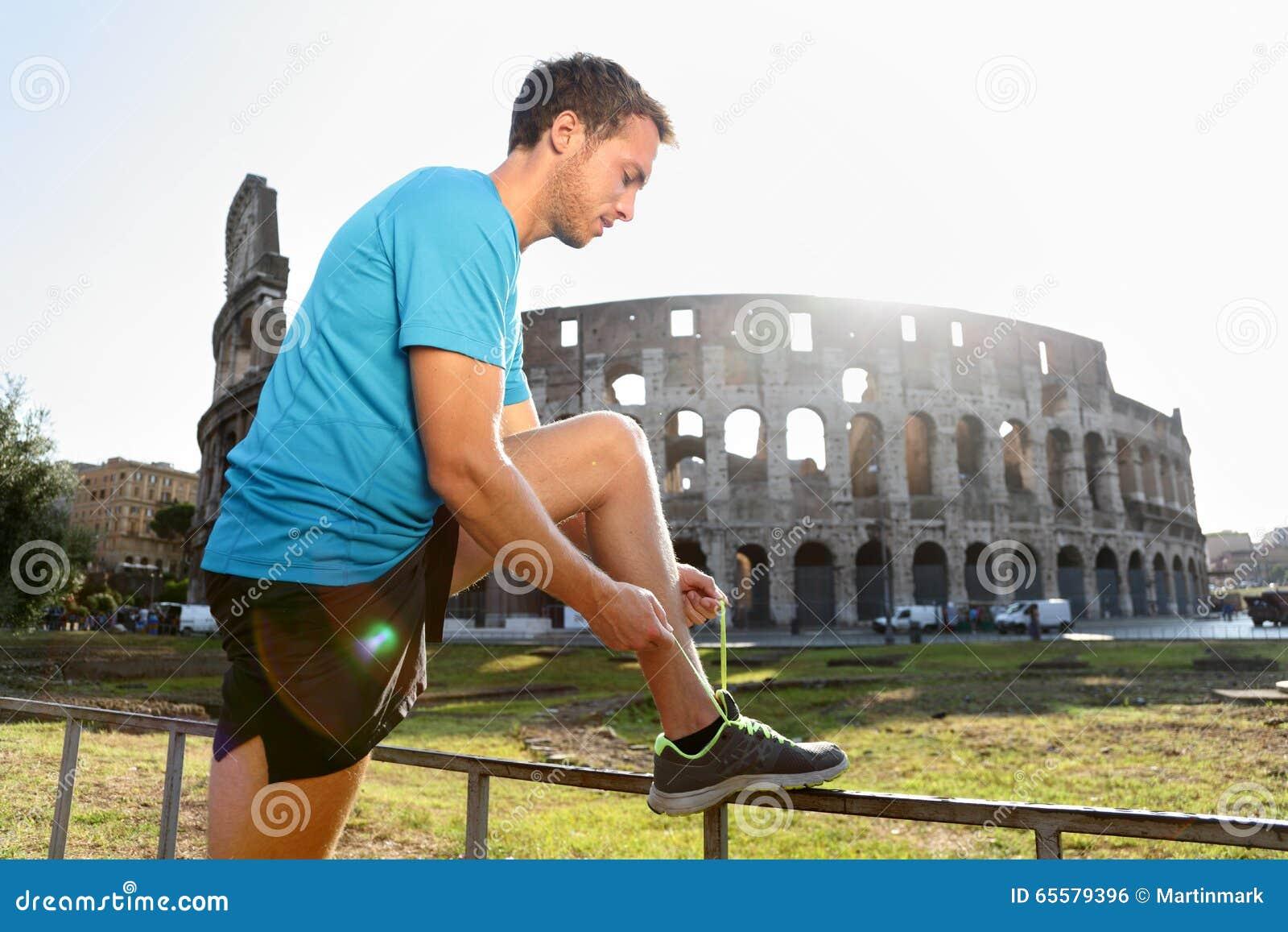 Basculador que corre amarrando laços por Colosseum