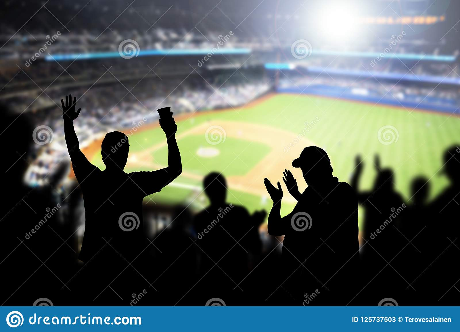 Baseball fans and crowd cheering in stadium.
