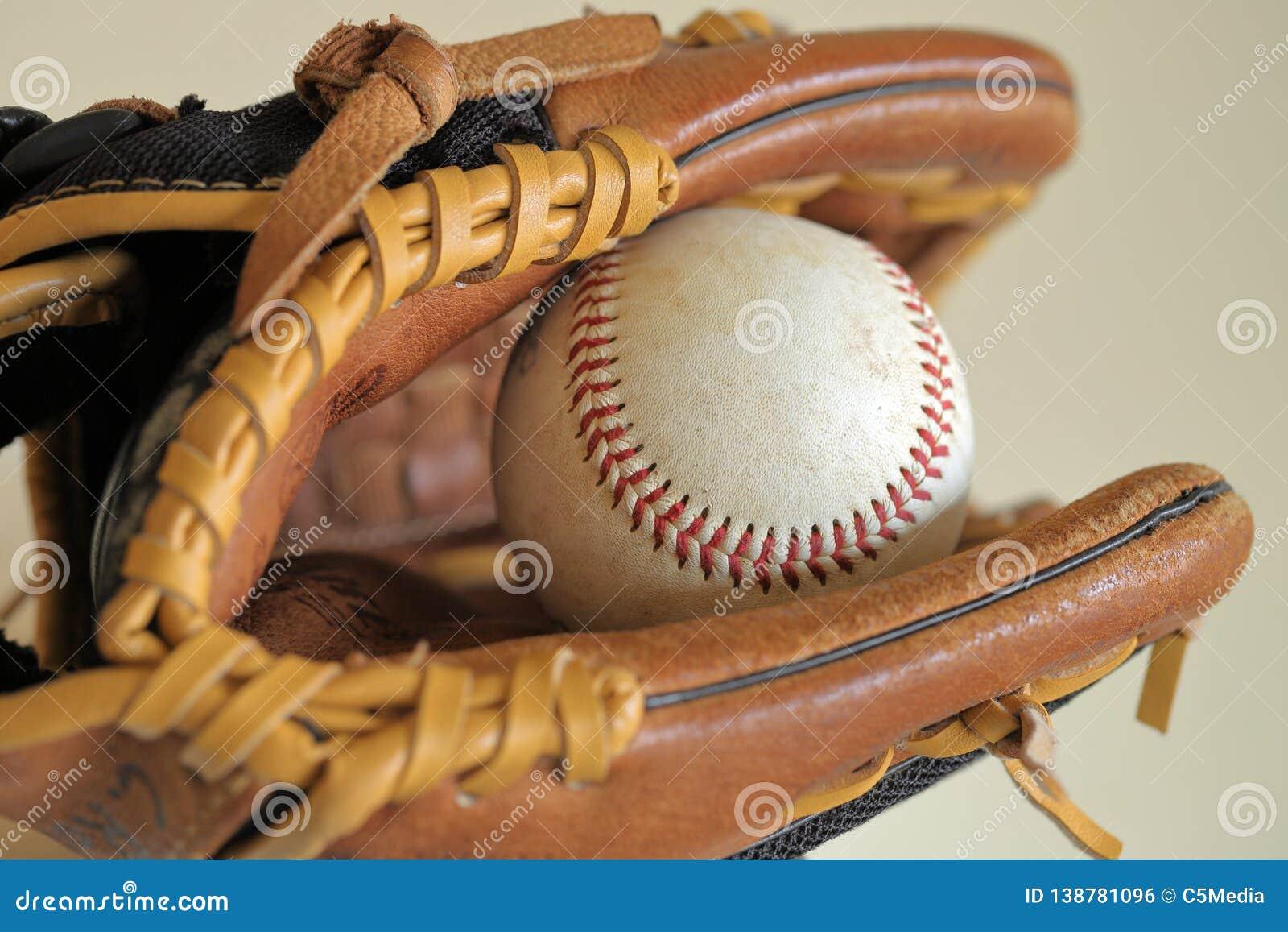 Baseball in leather glove - little league, sports