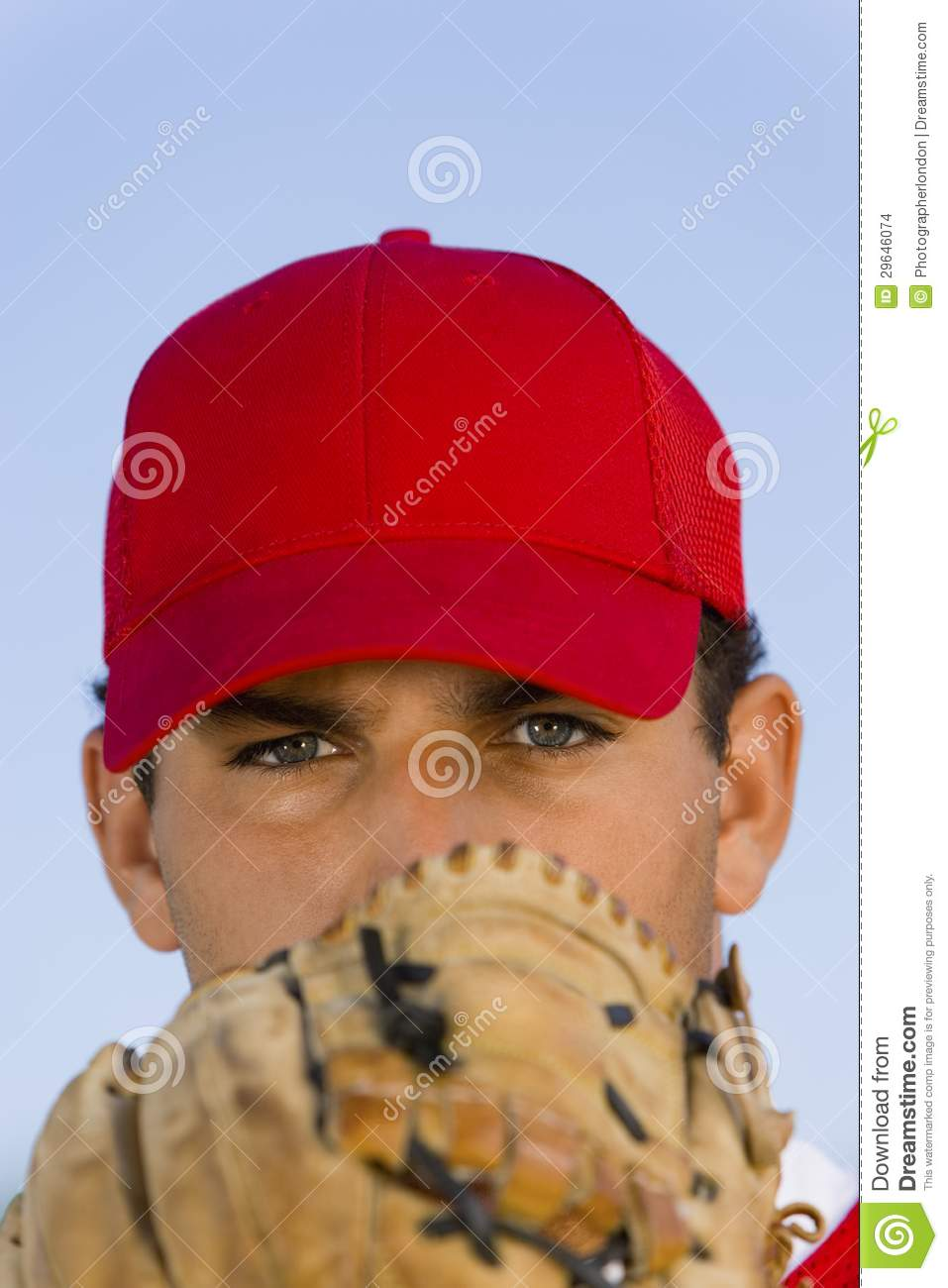 Baseball Pitcher Holding Glove In Front