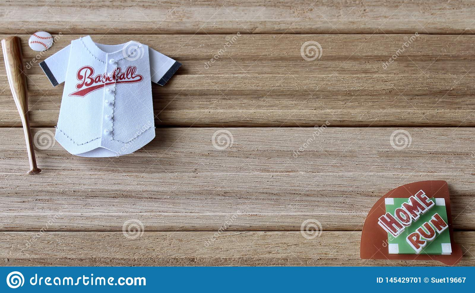 Baseball items on a wood background