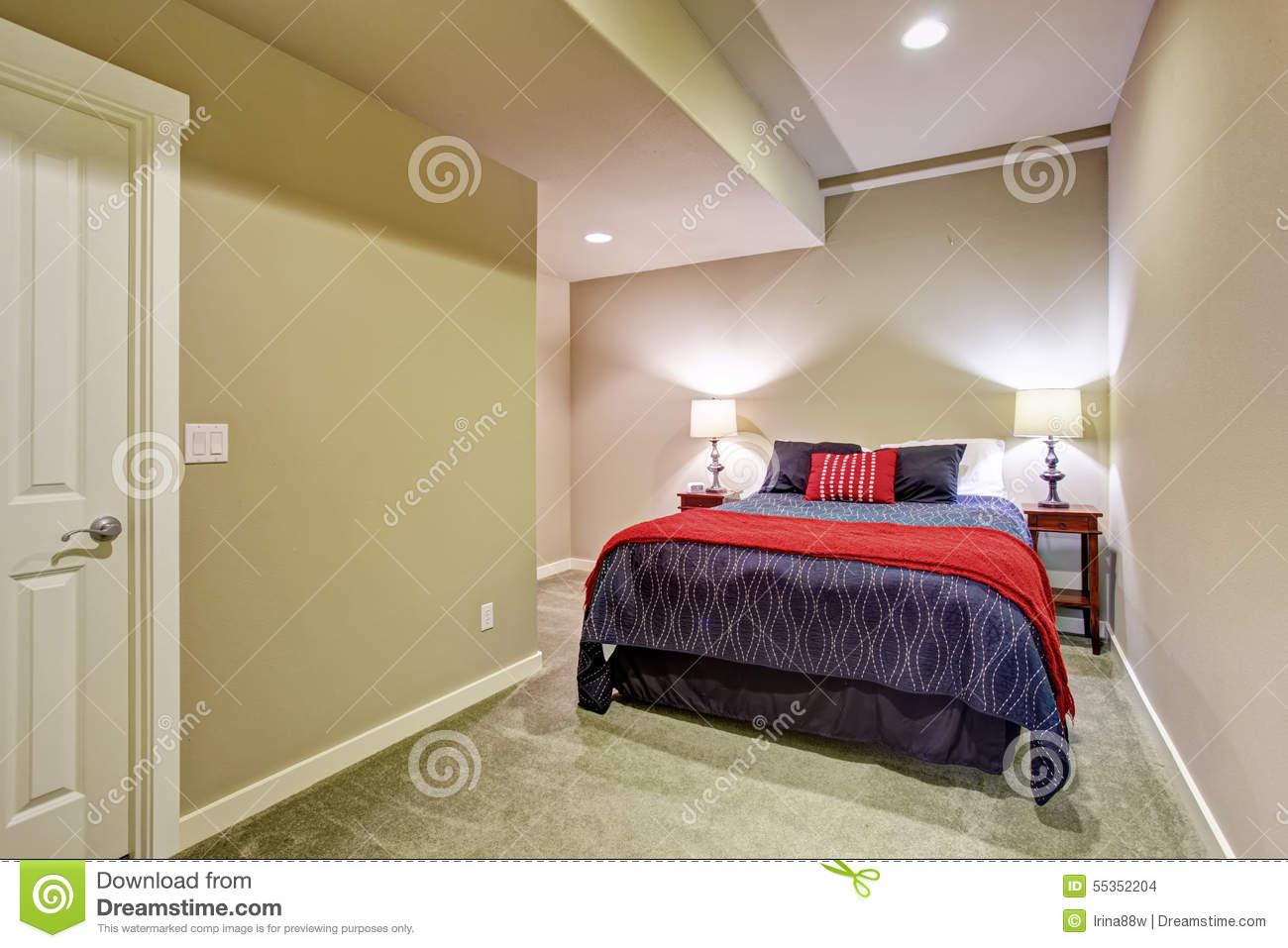 basement guest bedroom with blue and red bed stock photo image 55352204. Black Bedroom Furniture Sets. Home Design Ideas