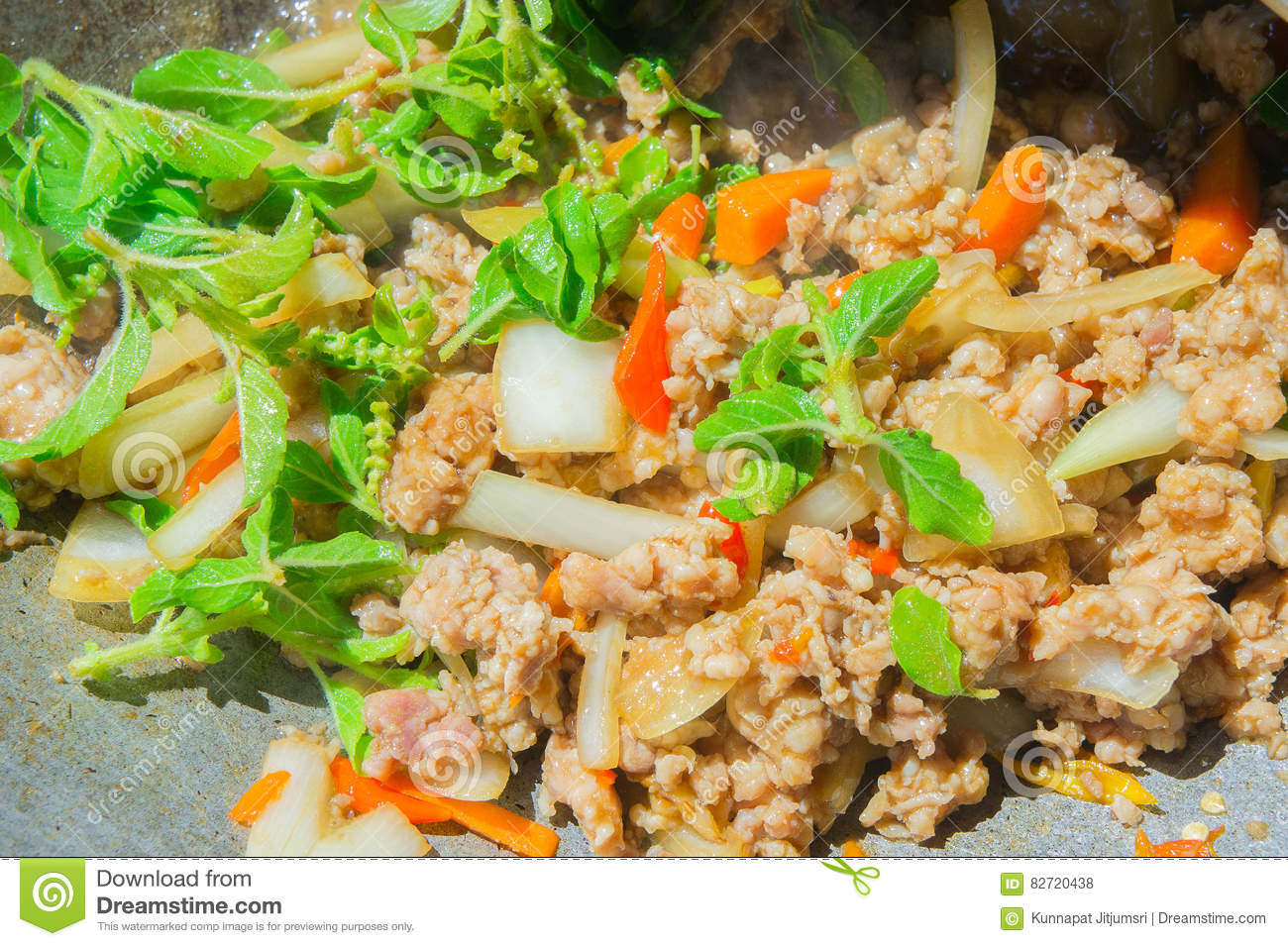 Basil Fried Pork Chops Cooking On A Hot Pan  Popular Food Of