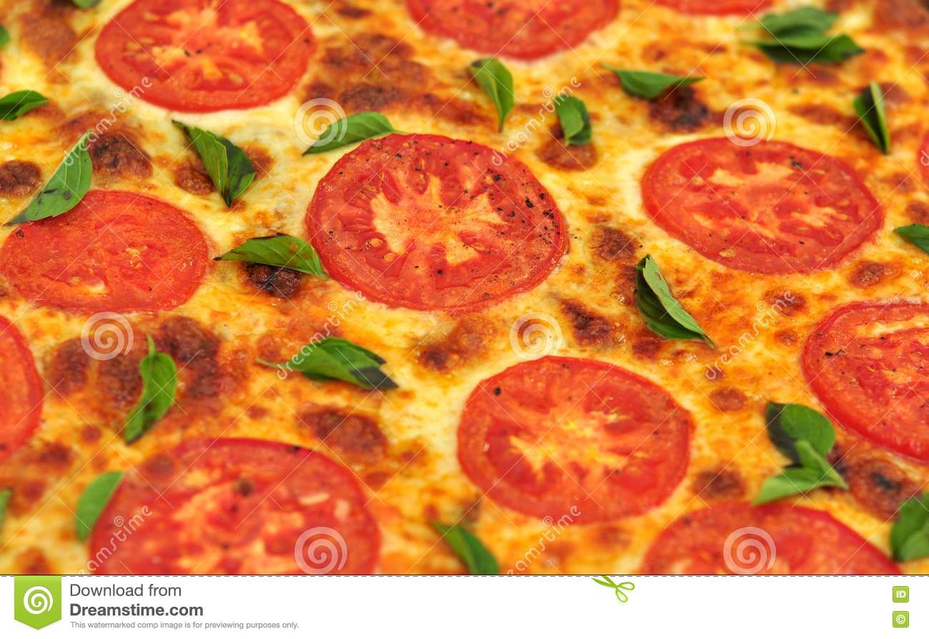 Closeup of a basil and tomato homemade pizza just fresh out of the ...