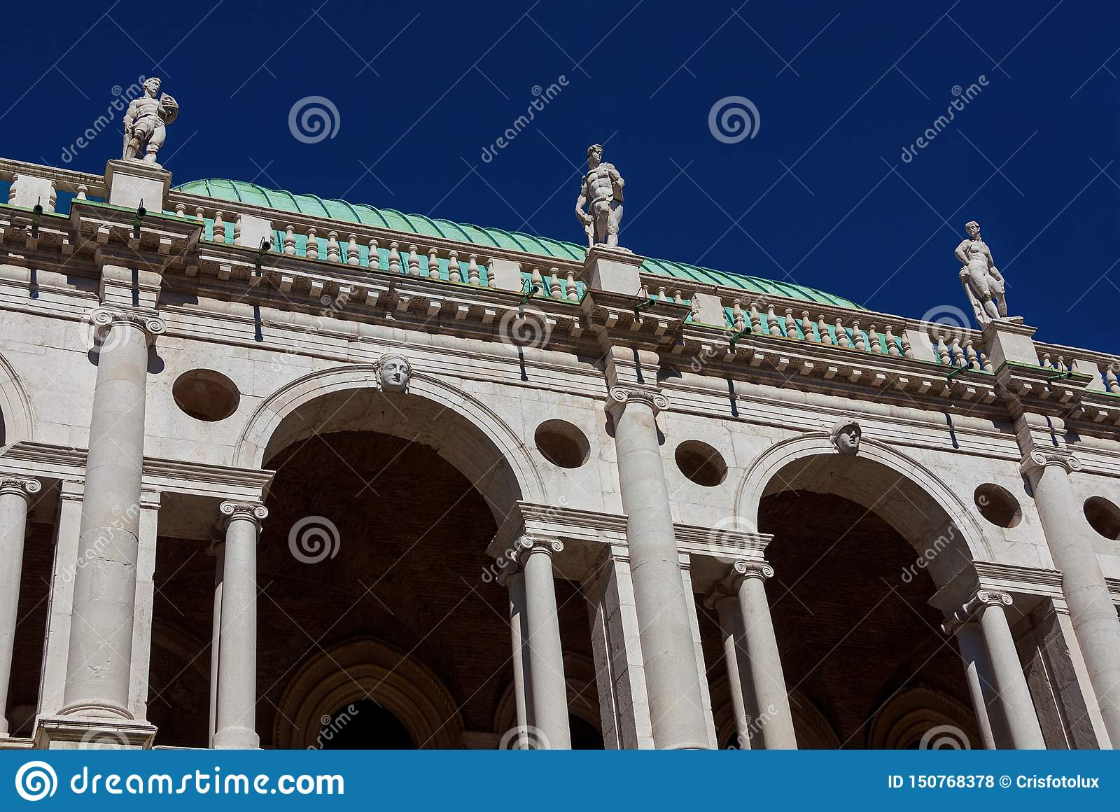 Basilica Palladiana arches and statues with blue sky