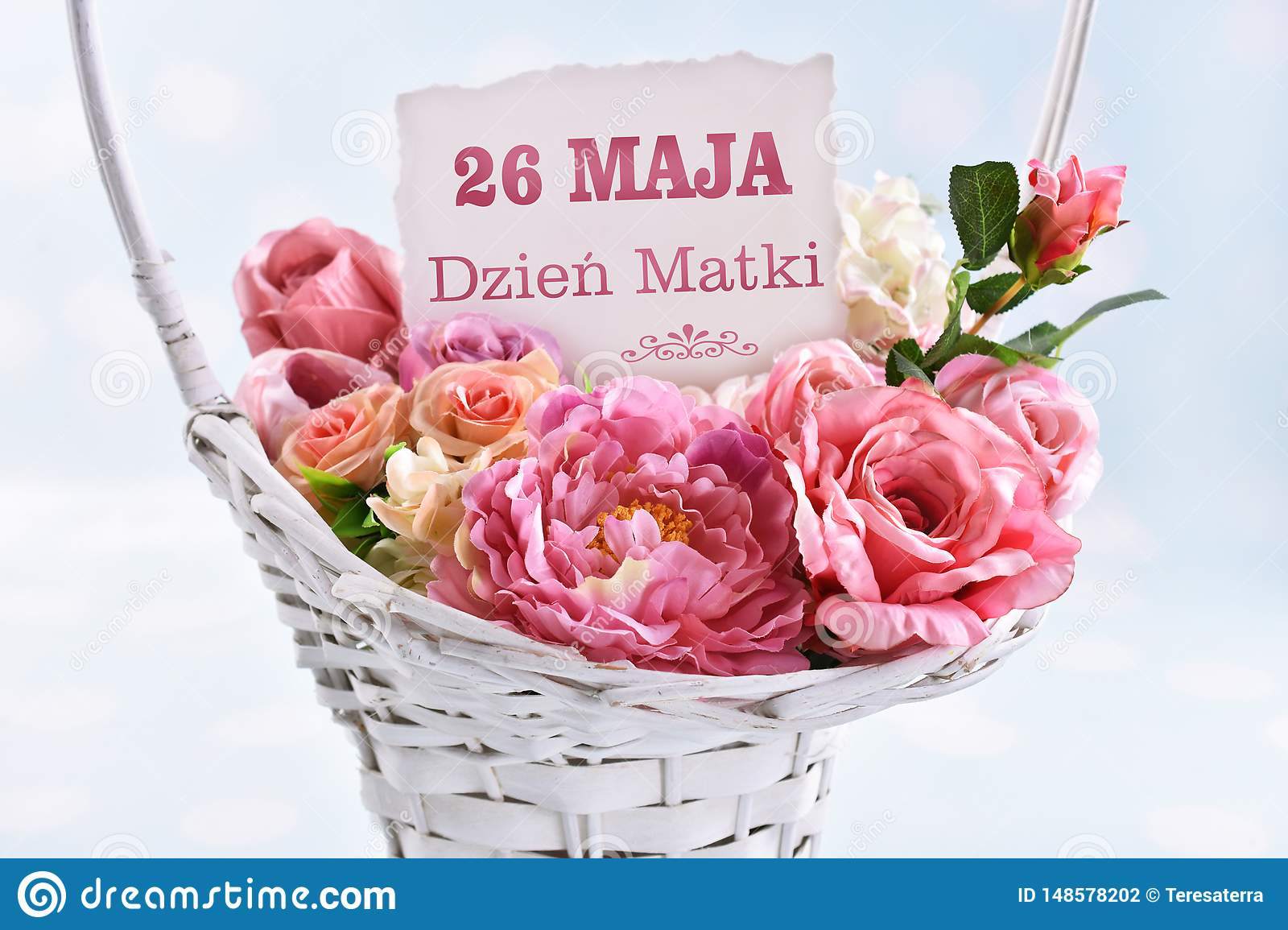 A basket of flowers for a mom with text in polish May 26th Mother day