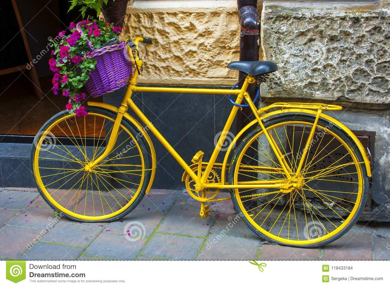 Yellow Bicycle With Flower Basket Stock Photo - Image of wall ...