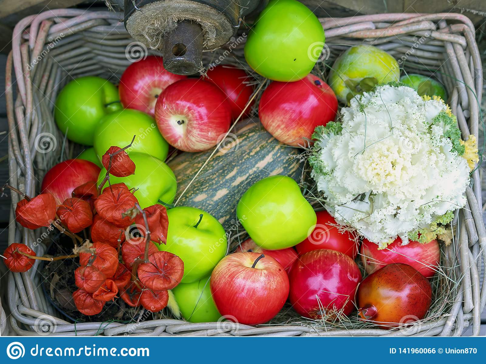 Basket with green, red apples and zucchini