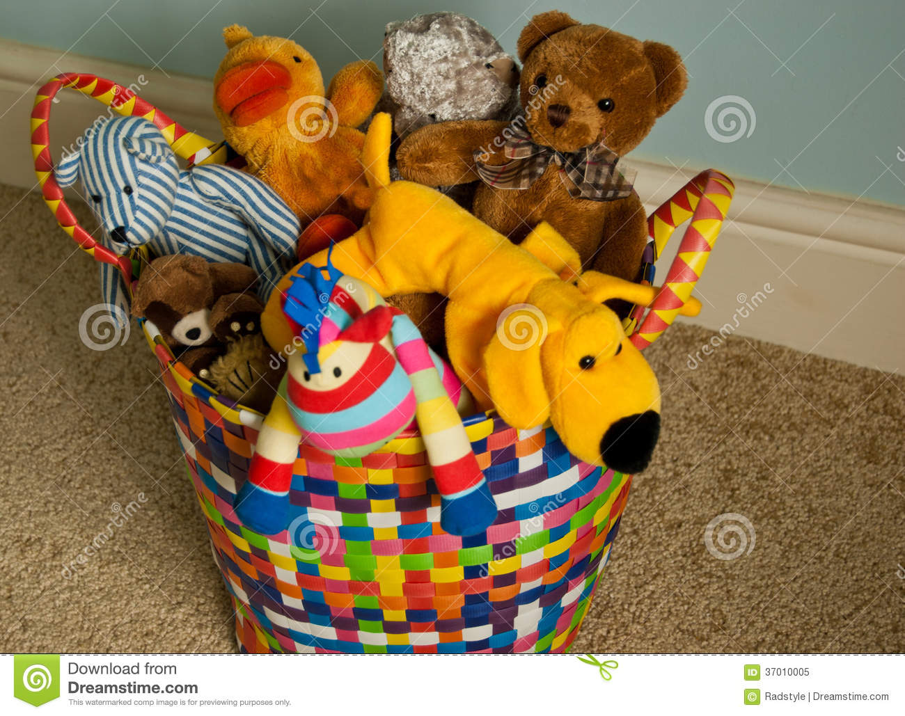 Room Filled With Soft Toys : Basket with plush animals on carpet stock image of
