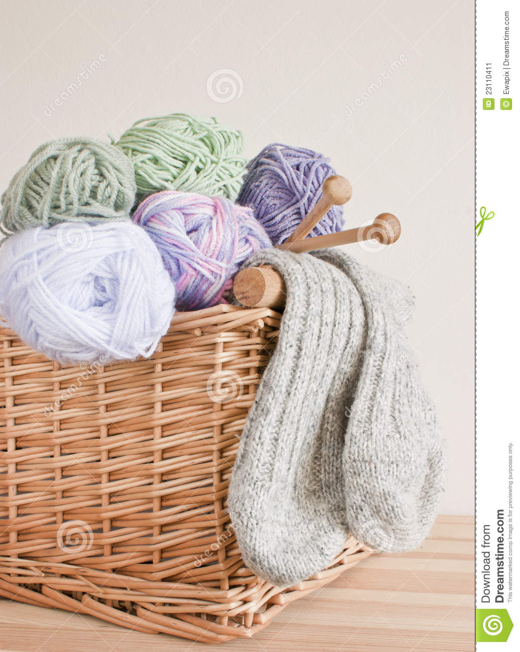 Basket With Wool, Knitting Needles And Socks. Stock Image - Image: 23110411