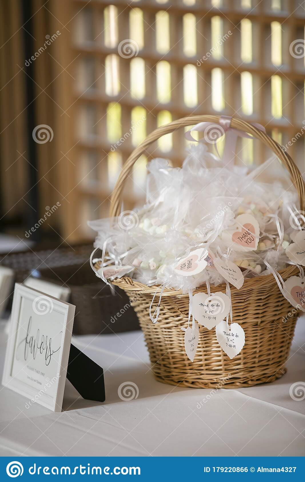 Basket Of Wrapped And Labeled Candies As Party Favors On A Table For A Wedding Ceremony Stock Photo Image Of Holiday Placard 179220866