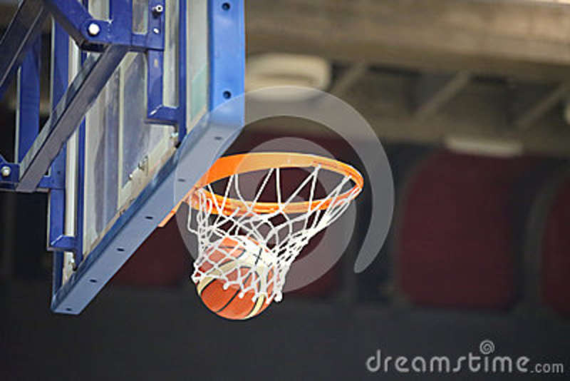 basketball going into the basket after a cool shot stock photo
