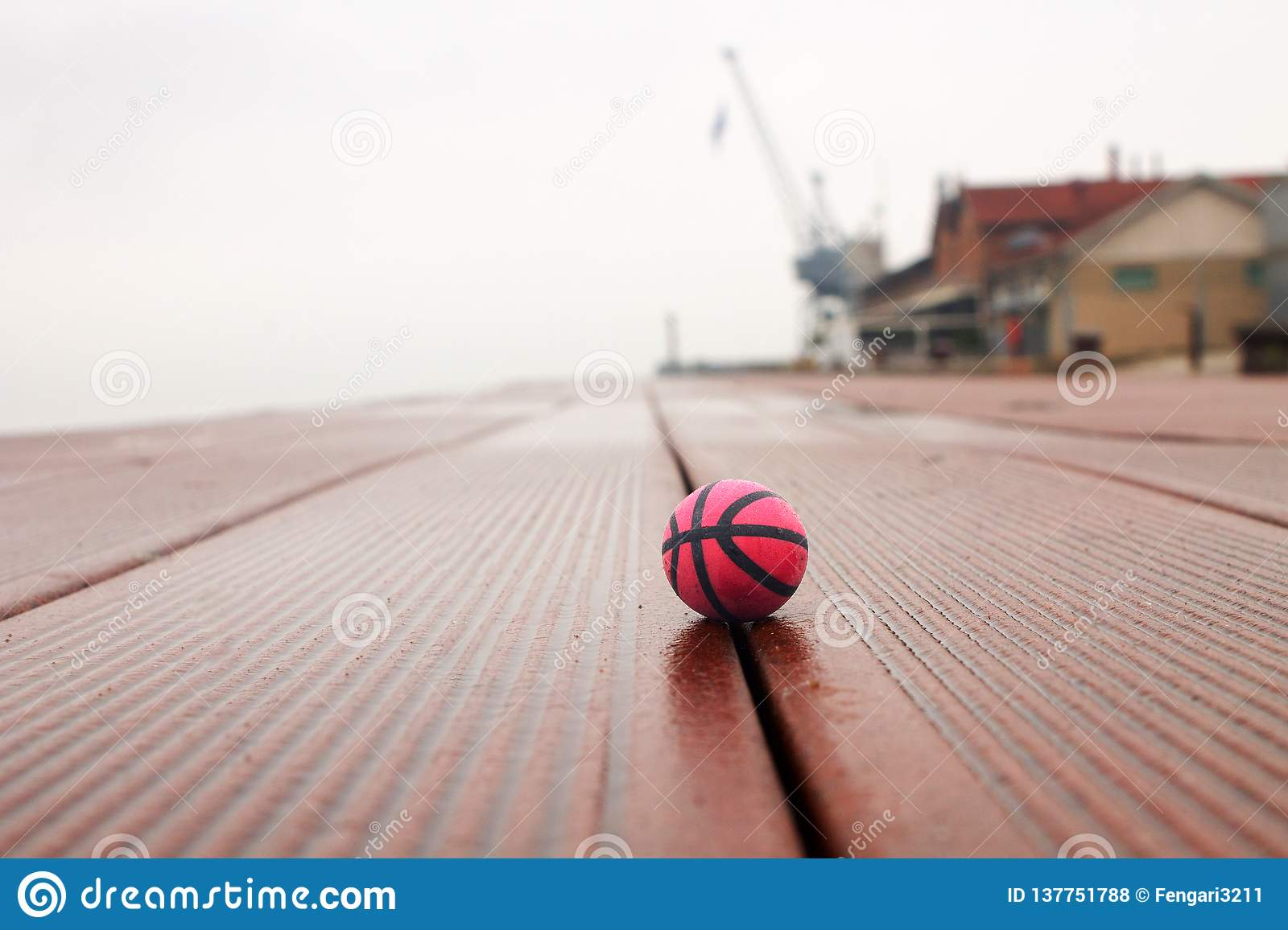 Basketball on the panels in the harbor