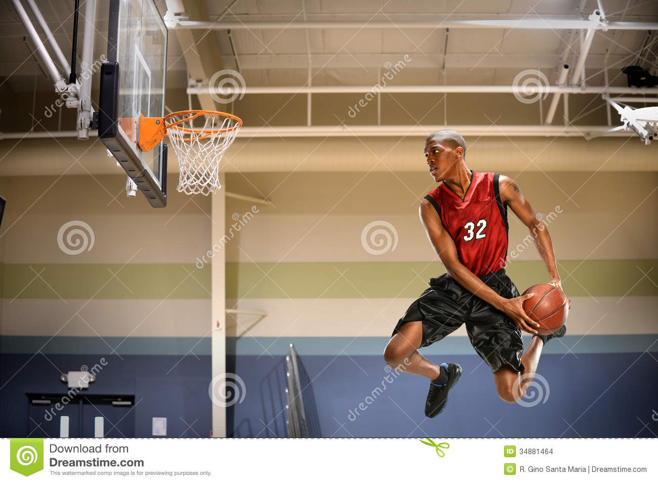 African american basketball player in action in indoor court.
