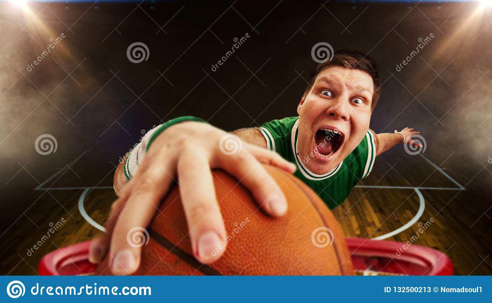 Basketball player throws ball, view from basket