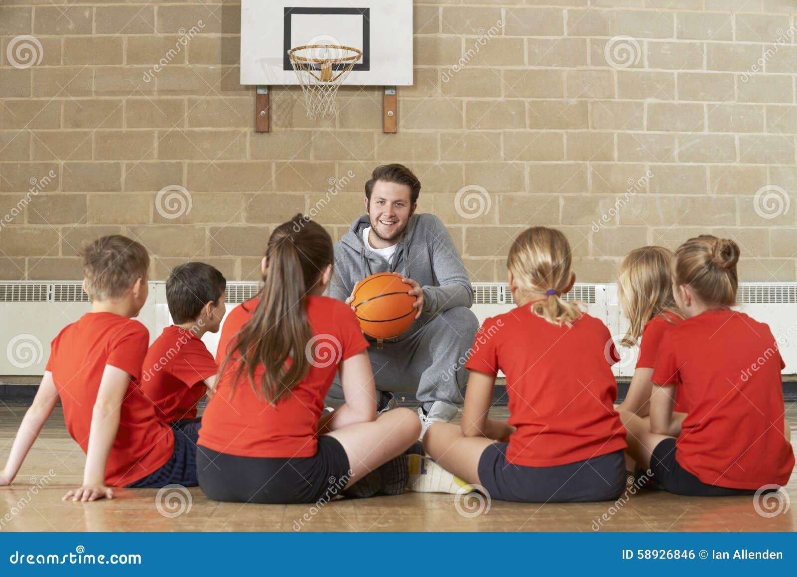 Basketball-Team Trainer-Giving Team Talk To Elementary School
