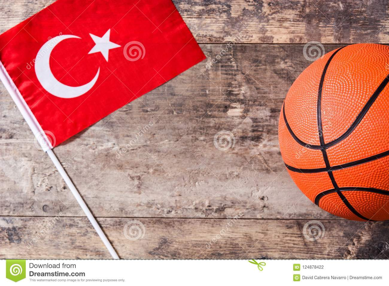 Basketball and Turkey flag on wooden table.