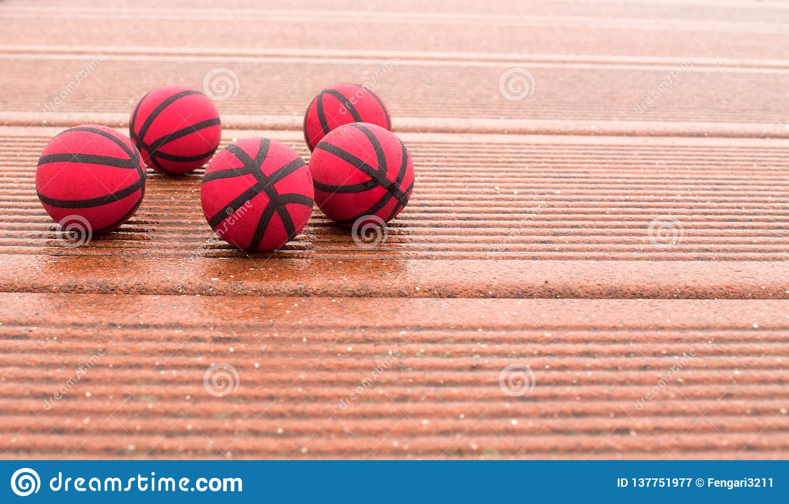 Five red basketballs on the texture panels