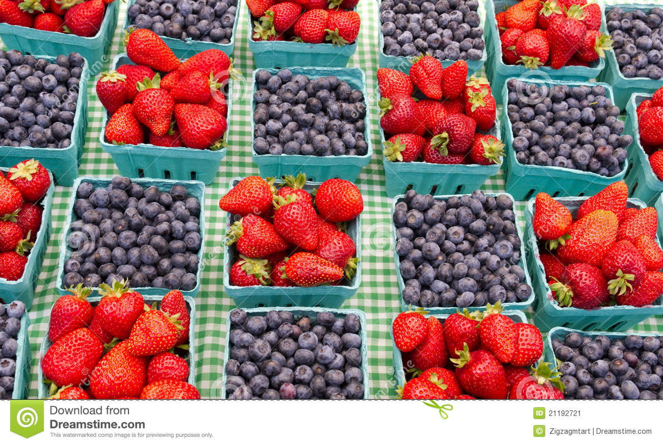 Baskets of strawberries and blueberries