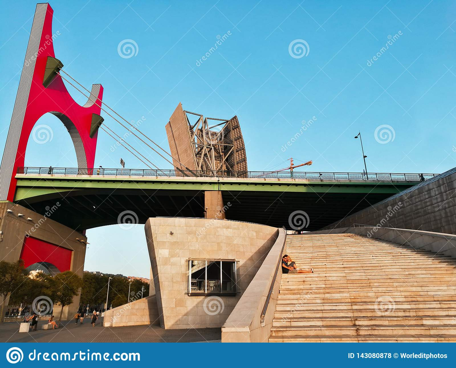 Basque country - september 11 - 2018: Couple resting at the stairs of la salve zubia bridge in Bilbo