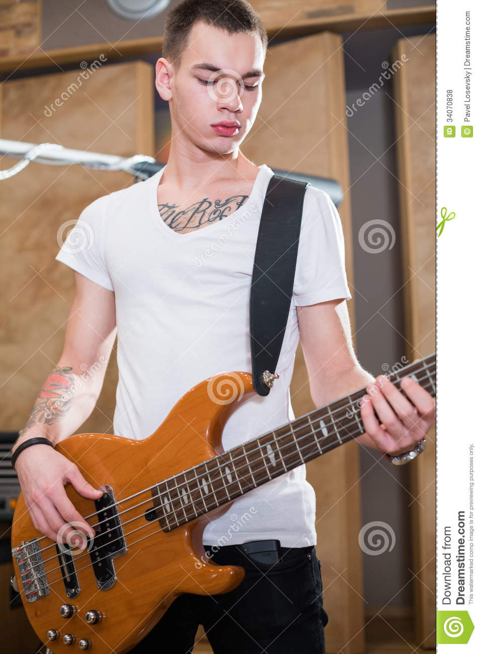 Bass player standing with his guitar