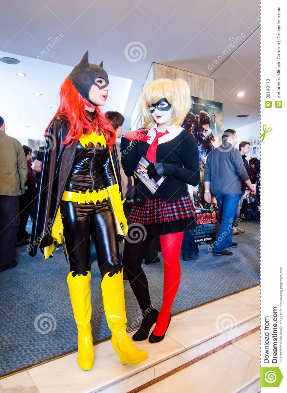 bat girl and harley quinn cosplayers editorial image